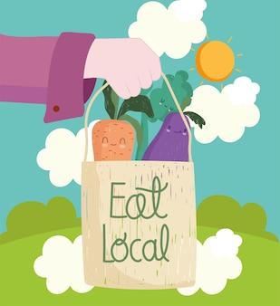 Main avec manger marché local