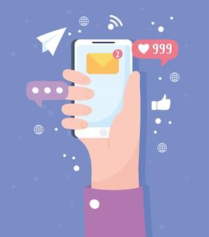 Main avec les messages de smartphone et les technologies et les systèmes de communication de réseau social suiveurs
