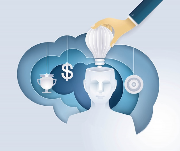 Main mettant une ampoule dans la tête humaine, avoir une idée, donner une motivation, idées créatives