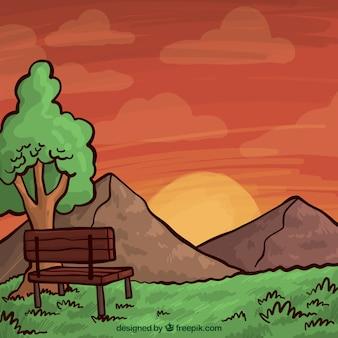 Main paysage dessiné, des tons chauds