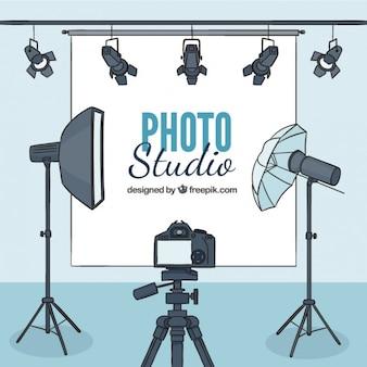 Main la photographie tirée studio avec accessoires