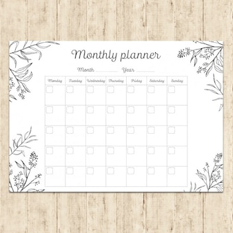 Main planificateur mensuel peint
