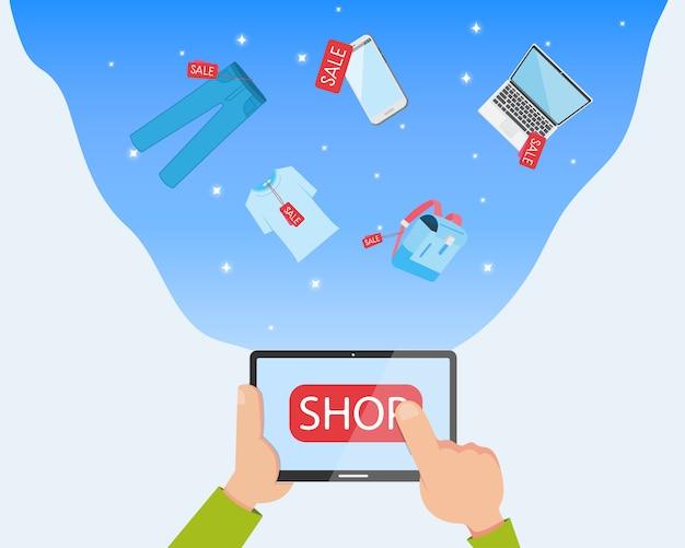 Main plate tenant une tablette et shopping e-commerce en ligne