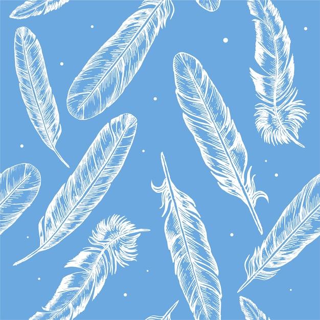 Main de plumes dessiner croquis boho ou motif de fond de style ethnique sur bleu.