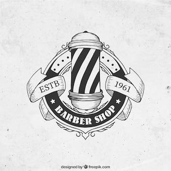 Main salon de coiffure dessinée logo dans le style vintage