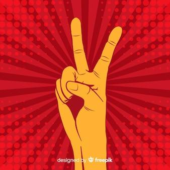 Main signe de la paix fond sunburst