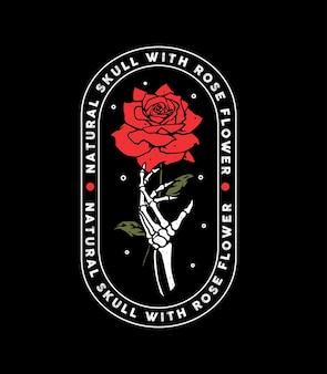 Main squelette avec motif fleur rose