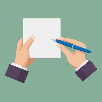 Main avec stylo écrit sur papier