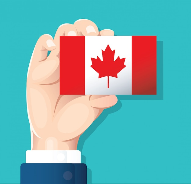 Main tenant la carte du drapeau du canada