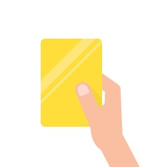 Main tenant la carte de football jaune. concept d'arbitre, suppression d'un terrain de football, mentor, violation des règles, présentation. illustration vectorielle de style plat tendance design moderne sur fond blanc