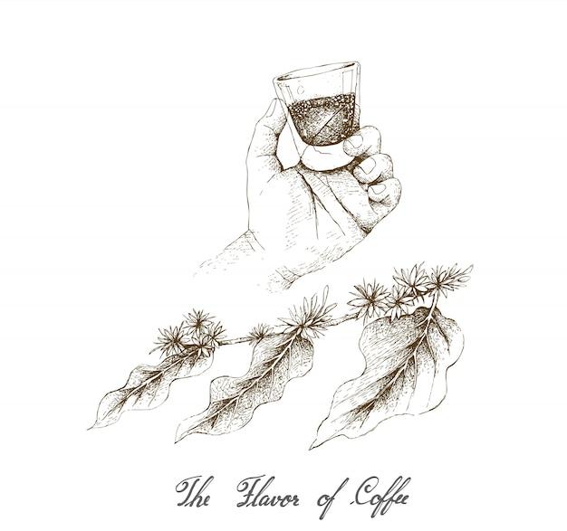 Main tenant un coup de café avec des fleurs de café