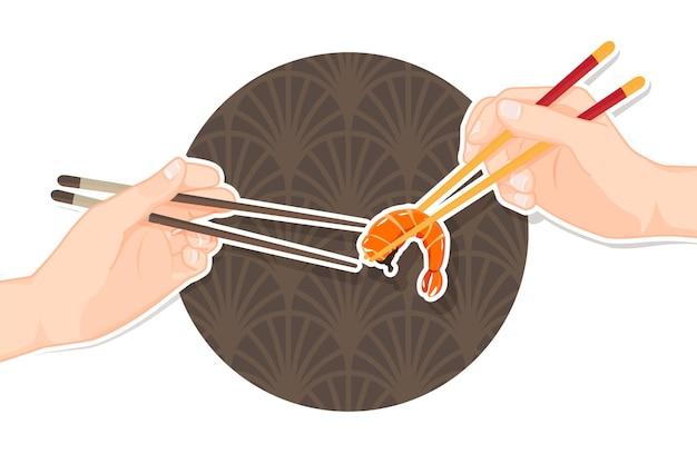Main tenant des crevettes avec des baguettes, des baguettes