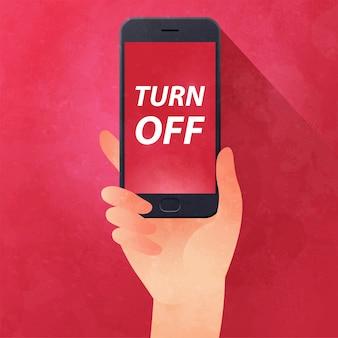 Main tenant une illustration de smartphone avec étiquette de désactivation sur rouge.