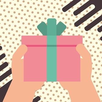 Main tenant la boîte-cadeau enveloppé ruban décoration