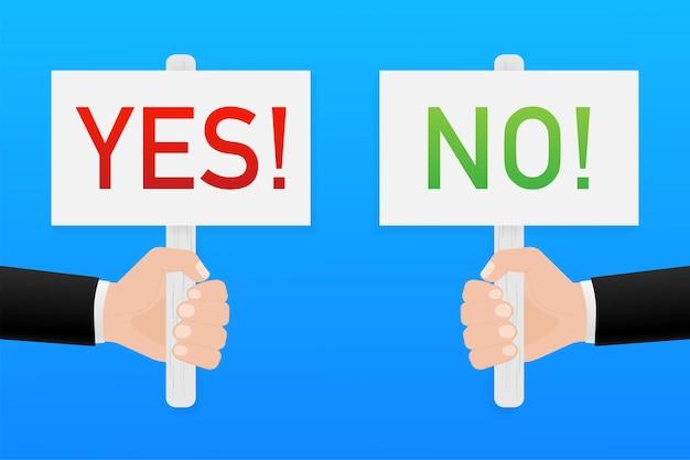 Main tenant une pancarte oui et non