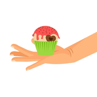 Main tenant un petit gâteau au coeur de chocolat