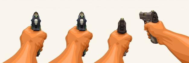 Main tenant le pistolet sur blanc