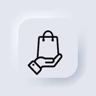 Main tenant le sac en papier. icône de sac à provisions. cliquez et récupérez la commande en ligne. vecteur. acheter le concept d'entreprise. bouton web de l'interface utilisateur blanc neumorphic ui ux. neumorphisme. vecteur