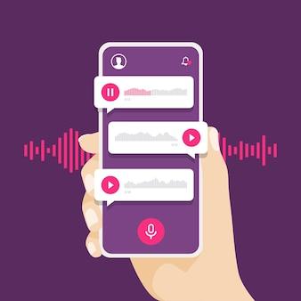 Main tenant le smartphone avec message vocal.