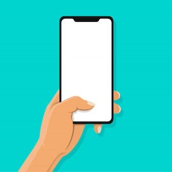 Main tenant le smartphone noir et le toucher du doigt sur un écran blanc vierge sur fond bleu.