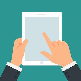 Main tenant la tablette à écran tactile sur vecteur de fond blanc