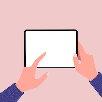 Main tenant une tablette
