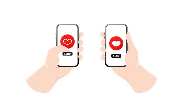 Main tenant le téléphone avec emoji coeur