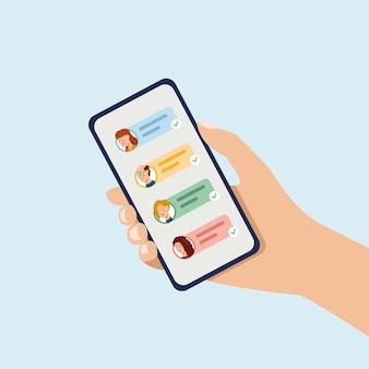Main tenant le téléphone avec des icônes de messages courts et des émoticônes discuter avec des amis et envoyer