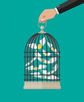 Main tient la cage avec de l'argent volant