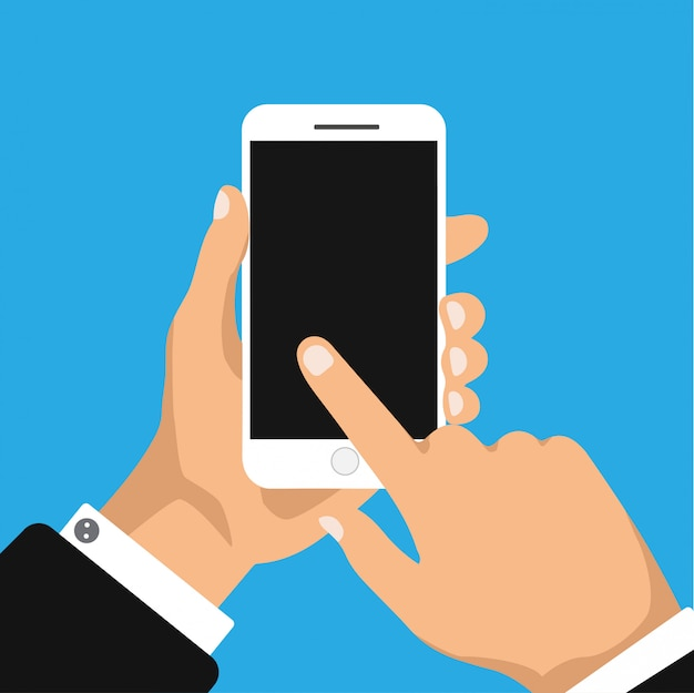 La main tient et clique sur le téléphone avec écran noir.