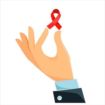 La main tient un ruban rouge le ruban rouge est un symbole de la lutte contre le sida
