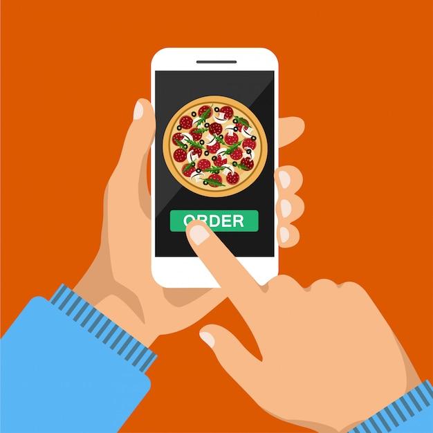 Main tient le smartphone et commande des pizzas en ligne. pizza sur l'écran du téléphone. isolé.