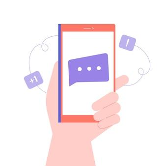 Main tient le smartphone. nouveau message, notification d'une lettre entrante, email. chats et communication en ligne. illustration plate.