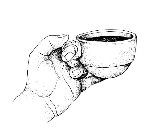 Main tirée d'une main tenant une tasse de café chaud