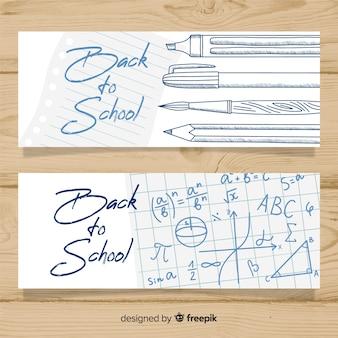 Main tirée vers les bannières de l'école