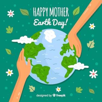 Main touchant le fond de la journée mère terre planète