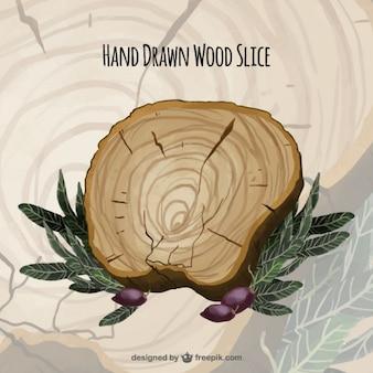 Main tranche de bois dessinée avec des feuilles