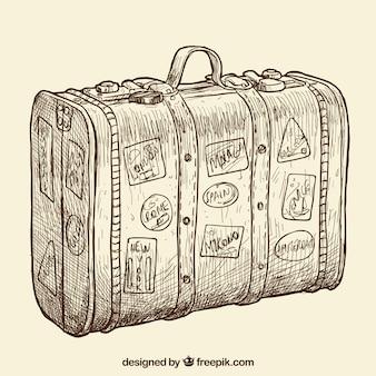 Main valise dessinée