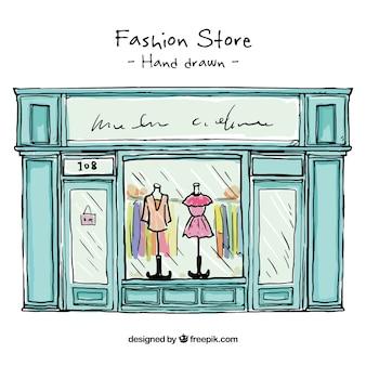 Main vitrine de magasin de mode dessinée
