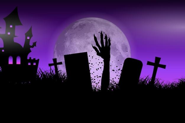 Main de zombie dans le paysage d'halloween