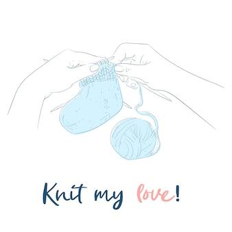 Mains avec des aiguilles à tricoter à la main.