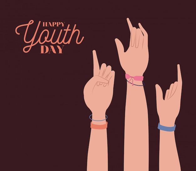 Mains en l'air du jour de la jeunesse