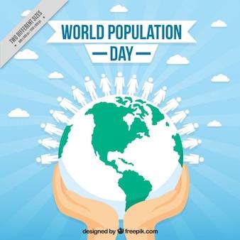 Les mains avec de l'arrière-plan du monde pour le jour de la population