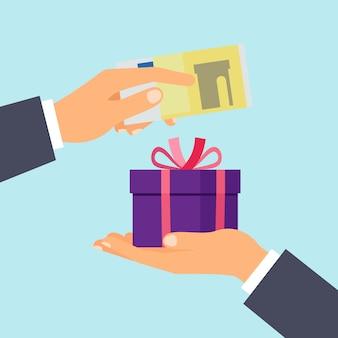 Mains avec billet en euros et cadeau