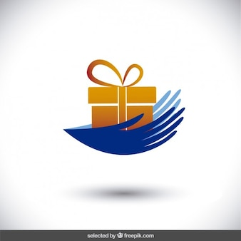 Les mains avec un cadeau