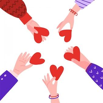 Mains en cercle avec coeurs.