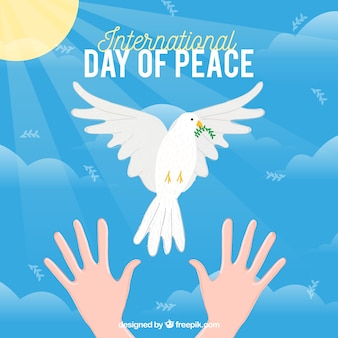 Mains, colombe blanche et soleil avec un design plat