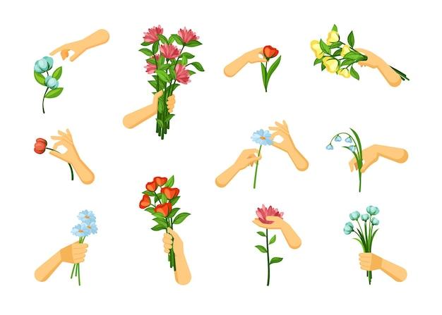 Mains cueillent et tiennent ensemble de fleurs