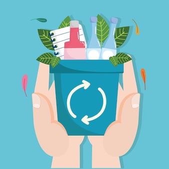 Mains avec des déchets de recyclage