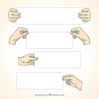 Mains dessinés à la main tenant des banderoles